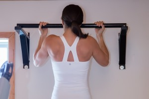 Fit Foodie Mama Doing Pull Ups